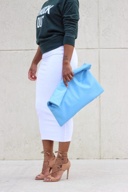 a light blue oversized soft clutch is a bright color statement in your spring look