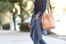 10 a navy denim ahcmbray shirt, blue jeans, strappy heels and a tan bucket bag