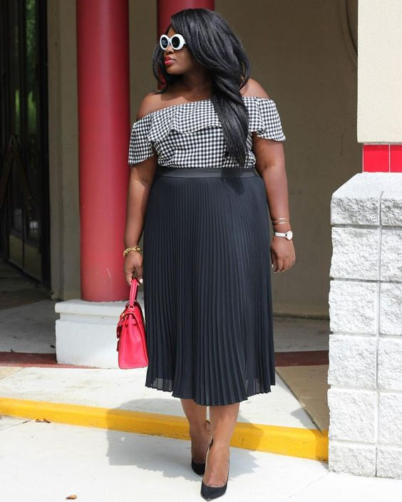 a chic date look with a black pleated midi, a checked off the shoulder top, black heels and a red bag