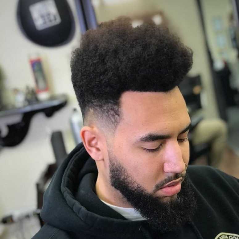 a curly high top fade is a cool idea to wear medium length and features a curly texture