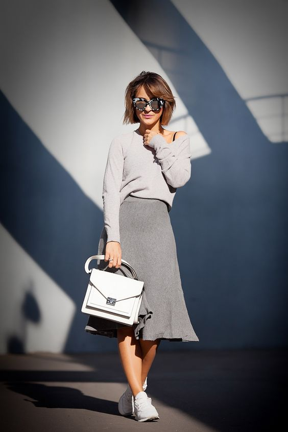 a girlish grey look for spring with a grey long sleeve top, a grey A-line skirt, a whiet bag and trainers