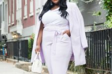 11 a lilac suit with a long blazer, a white top, white fur sliders and a small white bag