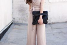 11 an oversized black clutch with a handle and matching mules for a trendy spring look