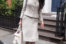 12 Amal clooney wearing a classic creamy Chanel skirt suit, a creamy bag and nude heels