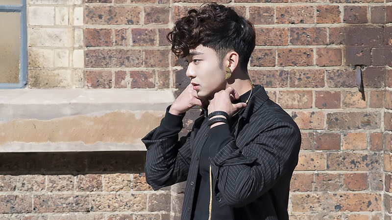 a curly pompadour features a long and curly top that contrasts the short sides