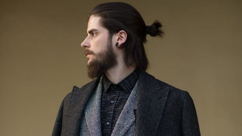 a half man bun for shorter locks and some hair down plus a beard for a bold look