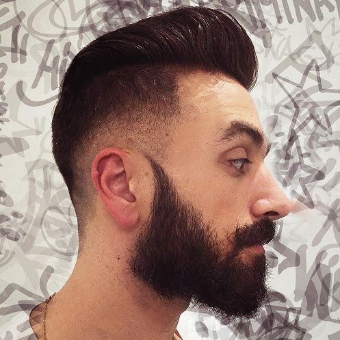 a high and tight pompadour haircut with a fade and a beard is a hipster like idea