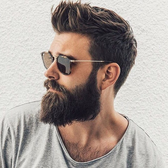 a hispter faux hawk with connecting sideburns and a full beard is a bold idea
