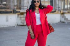 12 a hot red pantsuit with a white top, layered necklaces, nude shoes and a printed bag