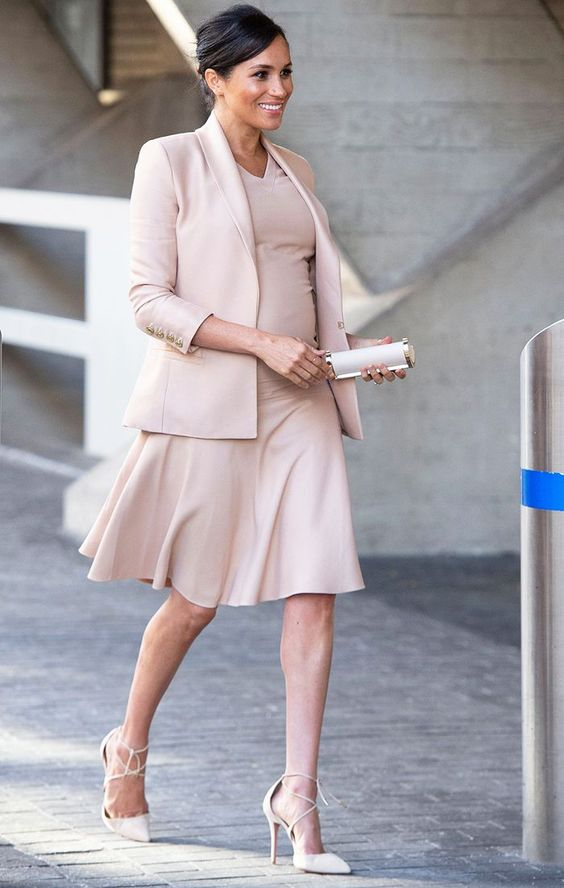 a soft blush beige outfit with a dress and a blazer by Meghan Markle