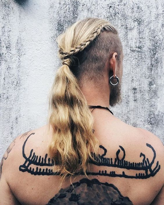 long hair with shaved sides, a braid and a long ponytail for a wild look