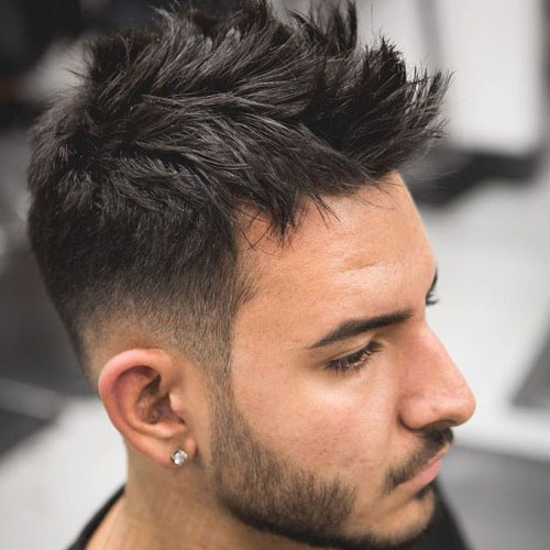 a layered faux hawk brings much texture, is easy to style and a beard adds chic
