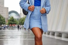 13 a light blue skirt suit with a mini, a bold blue top and trainers to sport up your look