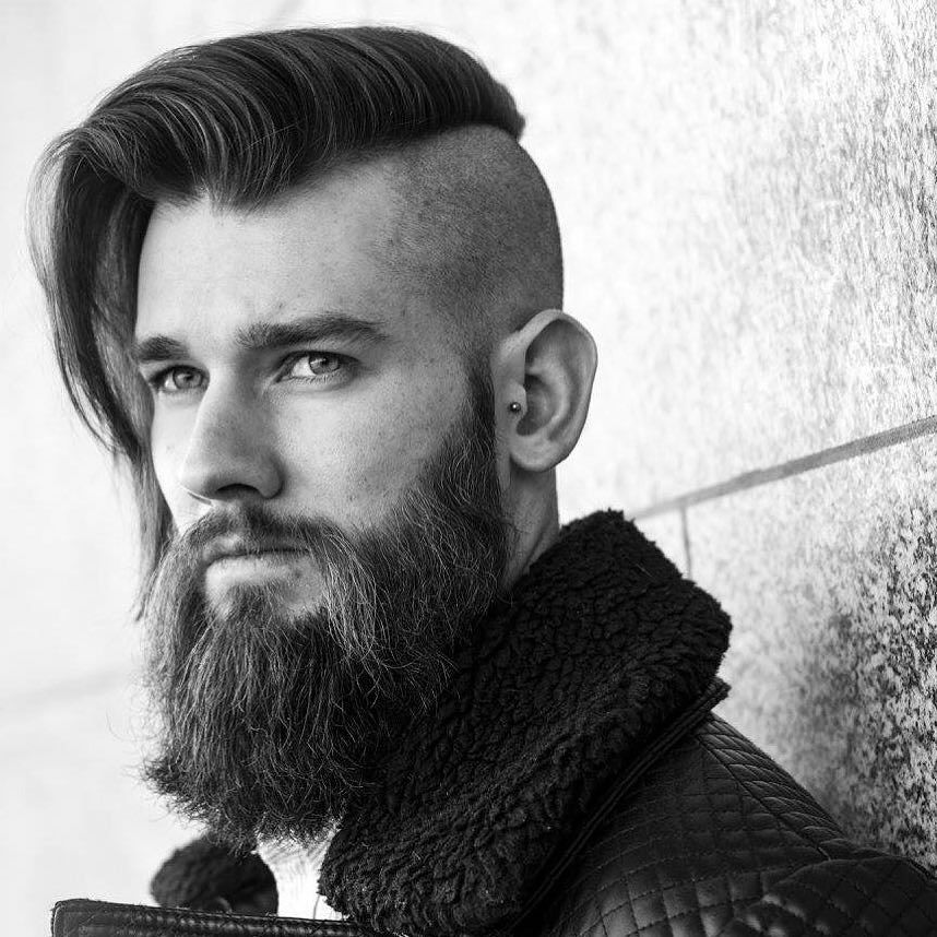 a long straight haircut with a disconnection and a beard is a very catchy masculine idea