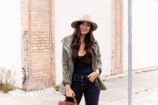 13 a relaxed look with a black top, ripped jeans, an olive grene jacket, a hat and nude heeled sandals