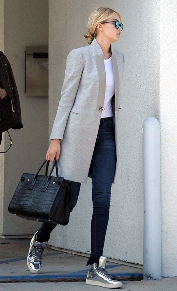 a relaxed office look with navy skinnies, a white tee, a grey coat, grey sneakers and a black crocodile leather bag