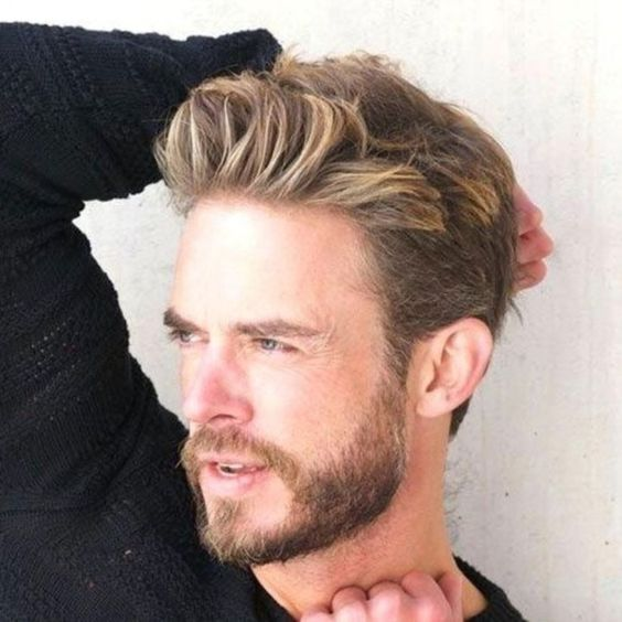 a trendy short haircut with blonde highlights and a beard is a chic idea to rock