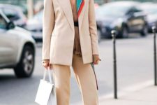 14 a beige outfit with a suit, a crochet top, a bold scarf and trainers