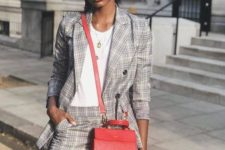 14 a grey checked suit with a mini skirt with pockets, a white top and a red crossbody