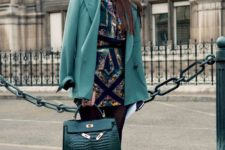 14 a hot party look with a bold printed romper, a green blazer, black heels and a grene crocodile leather bag