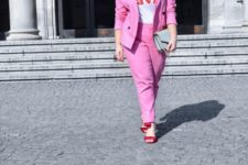 14 a hot pink pantsuit, a printed tee, red heels and a grey bag will give your look an edge