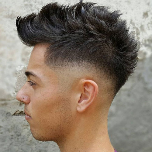 a long faux hawk with fade and curved hair is a trendy idea with much volume