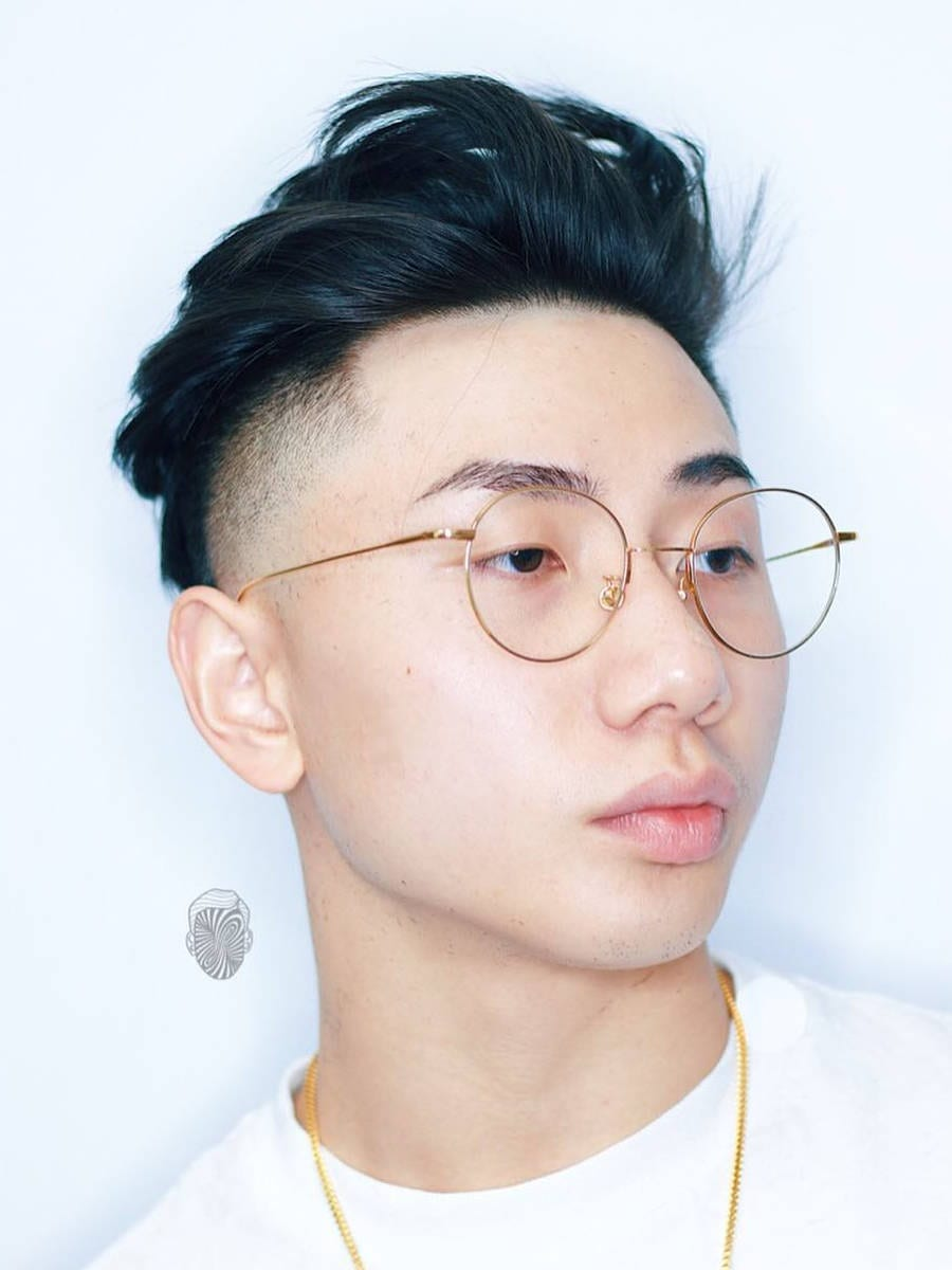 a messy hairstyle with a disconnected undercut is a perfect younger option to get most of your face shape
