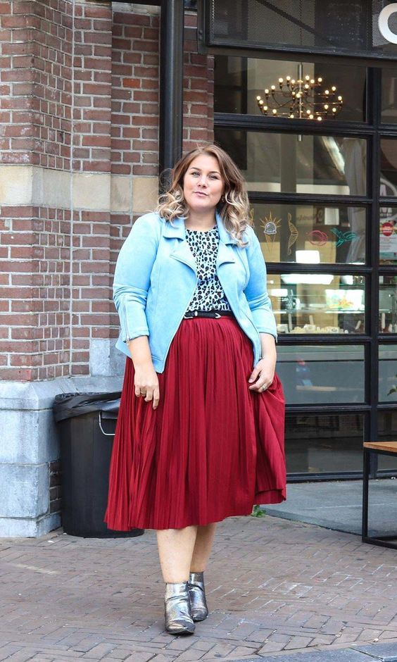 a red midi skirt, a leopard top, metallic boots and a blue jacket for spring