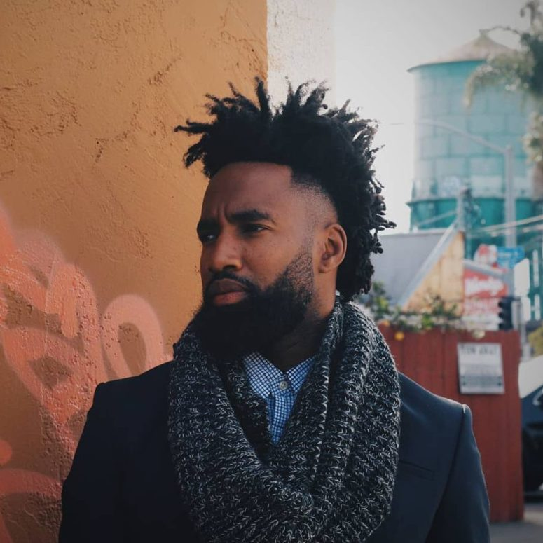 short dreadlocks and a temple fade gives a gentleman feel and a mohawk profile out of short hair