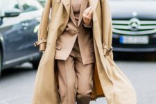15 a beige suit and a top, white sneakers and a camel coat on top