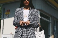 15 a black and white gingham skirt suit with a mini, a white shirt and a white bag