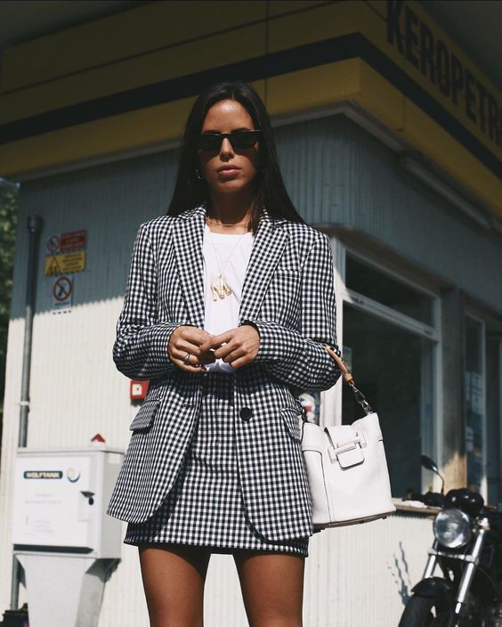 a black and white gingham skirt suit with a mini, a white shirt and a white bag