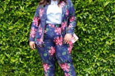 15 a navy floral print pantsuit with a striped blue shirt, hot pink shoes and a pink bag