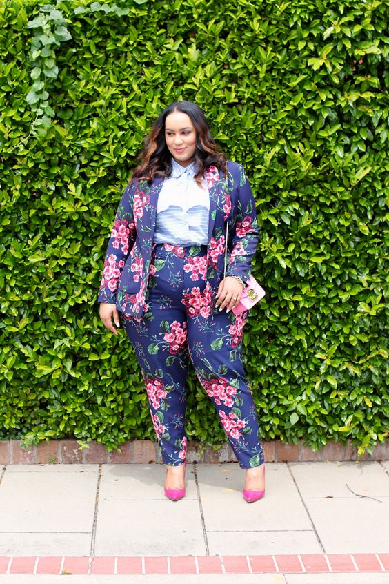 a navy floral print pantsuit with a striped blue shirt, hot pink shoes and a pink bag