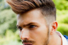15 a spiked long faux hawk with fade requires styling and looks very rock-inspired