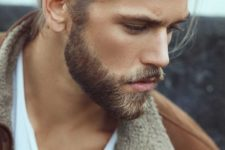 15 wear your long hair in a man bun and add a beard to look super edgy