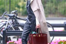 16 Olivia Palermo in leather overalls, a classic duster, Dior boots and crocodile Hermès Birkin bag