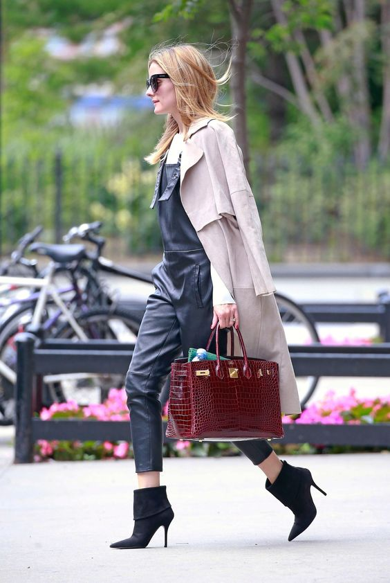 Olivia Palermo in leather overalls, a classic duster, Dior boots and crocodile Hermès Birkin bag