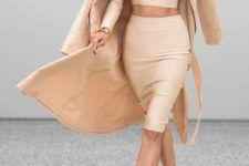 16 a creamy crop top and pencil skirt, tan strappy shoes, a tan trench