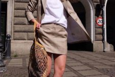 16 a neutral suit with a mini skirt, a white tee, white socks and blue sneakers