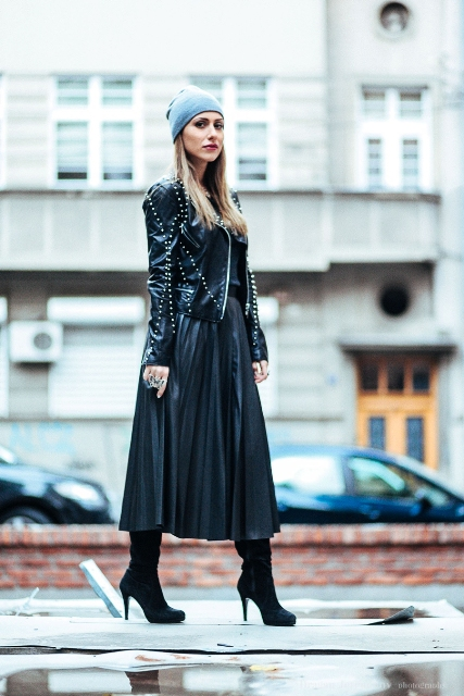 With beanie hat, leather midi skirt and boots