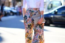 With beige clutch, beige suede shoes and white blouse