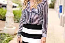 With black and white striped mini skirt and black tote bag