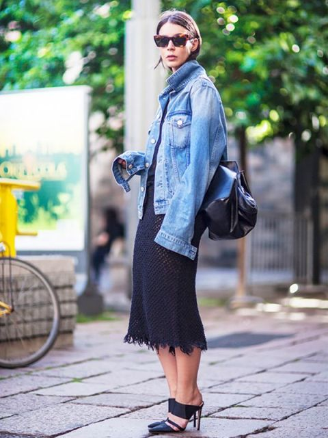 With black backpack, navy blue dress and mules