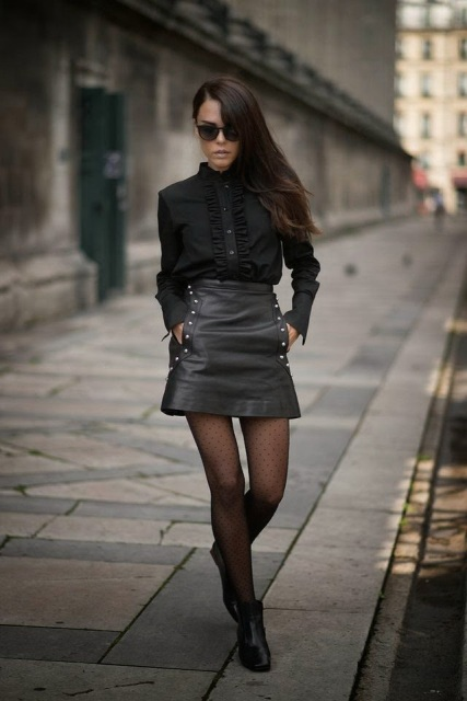 With black blouse, sunglasses and black boots