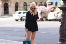 With black dress and velvet chain strap bag