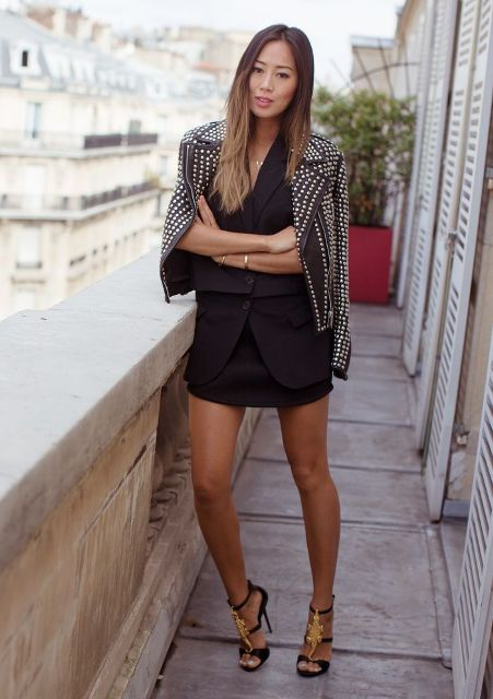 With black jacket, mini skirt and high heels