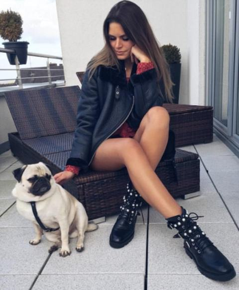 With black leather jacket and printed mini dress