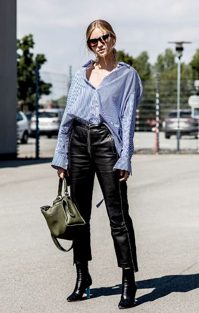 With black leather pants, ankle boots and olive green bag