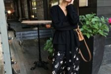 With black long blouse, black pumps and brown bag